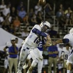 Fairhope QB throws a pass against St. Paul's in the Saints' victory over the Pirates. (Photo by Brad McPherson)