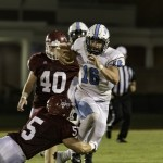 MGM QB Cullan O'Shea breaks a tackle against UMS-Wright (Photo by Todd Stacey)