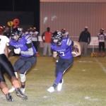 Pirate quarterback Buck Weaver scrambles for a gain. (Photo by Jason Boothe)